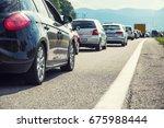 traffic jam on the highway in... | Shutterstock . vector #675988444