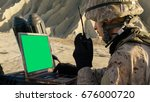 soldier is using laptop