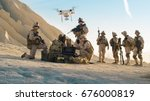 Soldiers are Using Drone for Scouting During Military Operation in the Desert. - stock photo