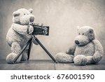 teddy bear toy photographer...   Shutterstock . vector #676001590