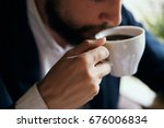 business man drinking coffee in ... | Shutterstock . vector #676006834