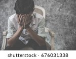 asian man sitting alone in the... | Shutterstock . vector #676031338