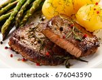 grilled beef steaks and... | Shutterstock . vector #676043590
