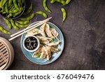 chinese dumplings on plate ... | Shutterstock . vector #676049476