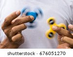 both blue and yellow spinner... | Shutterstock . vector #676051270