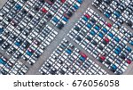 aerial view new cars lined up... | Shutterstock . vector #676056058