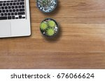 mock up laptop and cactus in... | Shutterstock . vector #676066624