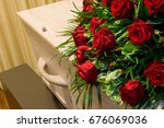 a coffin with a flower... | Shutterstock . vector #676069036