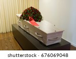 a coffin with a flower... | Shutterstock . vector #676069048