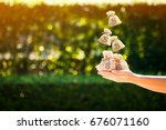 women hands hold a money bags... | Shutterstock . vector #676071160