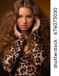 girl in leopard dress and black ... | Shutterstock . vector #676075030