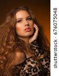 girl in leopard dress and black ... | Shutterstock . vector #676075048