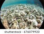 pebble beach with azure sea... | Shutterstock . vector #676079920