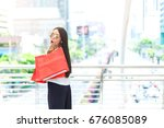 beautiful young woman hold... | Shutterstock . vector #676085089