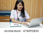 young asian doctor using laptop ... | Shutterstock . vector #676092820