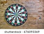 Stock photo dartboard on wood old wall high dynamic range tone 676093369