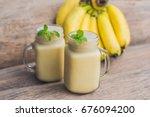 banana smoothies and bananas on ... | Shutterstock . vector #676094200