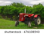 red tractor in the field on a... | Shutterstock . vector #676108543