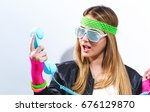 woman in 1980's fashion with...   Shutterstock . vector #676129870