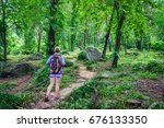 Small photo of Adventuress or traveler woman go hiking on trail in forest. The tropical jungle in Southeast Asia.
