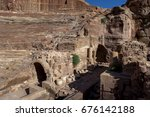 Small photo of PETRA, JORDAN - JUNE 11, 2014 : A section of the theatre ruins at the ancient site of Petra. The theatre has been dated to the first century AD before the Romans annexed Nabatea.