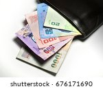 pack of thai money baht in... | Shutterstock . vector #676171690