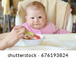 a cheerful happy child eats... | Shutterstock . vector #676193824