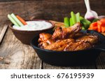 roasted chicken wings with... | Shutterstock . vector #676195939