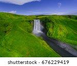 skogafoss and a hint of a... | Shutterstock . vector #676229419