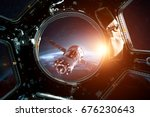 porthole of space station and... | Shutterstock . vector #676230643