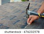 worker hands installing bitumen ... | Shutterstock . vector #676232578