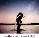 Woman On Water Background At...