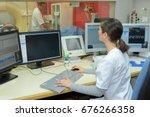 nurse using computer at... | Shutterstock . vector #676266358