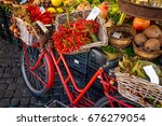 red old bike in market on campo ... | Shutterstock . vector #676279054