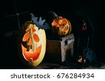 Two Carved Pumpkins With...
