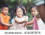 asian children having fun to... | Shutterstock . vector #676287874