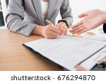 business woman signing... | Shutterstock . vector #676294870