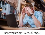 young man trying hard to come... | Shutterstock . vector #676307560