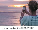 young women taking photo to the ... | Shutterstock . vector #676309708
