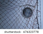 ship window with fishing net | Shutterstock . vector #676323778