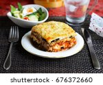 a piece of eggplant lasagna on... | Shutterstock . vector #676372660