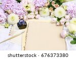 Small photo of Vintage stationery set and pastel colors flowers around, copy space.