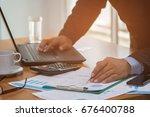 a businessman analyzing... | Shutterstock . vector #676400788