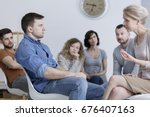 therapist speaking to a man... | Shutterstock . vector #676407163