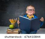 hardworking child is reading... | Shutterstock . vector #676410844