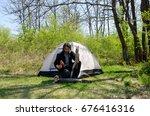 man chopping wood | Shutterstock . vector #676416316
