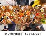 online at dinner. gadget device ...   Shutterstock . vector #676437394