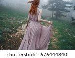woman in a long dress walking...   Shutterstock . vector #676444840