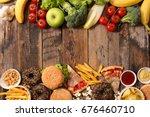 junk food or health food concept | Shutterstock . vector #676460710