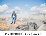 a young smiling boy sits on a... | Shutterstock . vector #676461319
